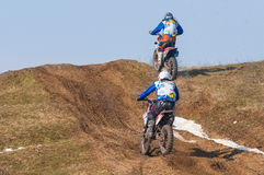 Two enduro racers. With mud on motorbike climbing hill Royalty Free Stock Photography