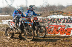 Two enduro racers. With mud on motorbike preparing to start stock photos