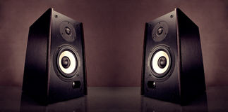 Two energy audio speakers. On a brown background Royalty Free Stock Photos