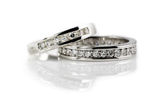 Two engagement rings. Two platinum engagement rings with diamonds on white background Royalty Free Stock Photo