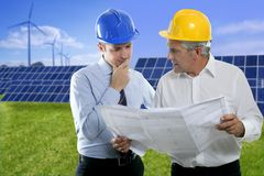 Two engineer architect plan hardhat solar plates Stock Photos
