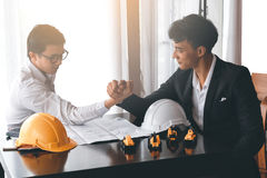 Two engineer or businessman engage in arm wrestling. Concept of battle or fighting Royalty Free Stock Photography