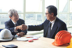 Two engineer construction business man shaking hand after projec Royalty Free Stock Photography