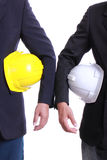 Two Engineer people holding safety hat Royalty Free Stock Photography