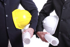 Two Engineer people holding safety hat Stock Image