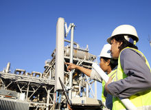 Two engineer power and energy pointing. Two engineer power and energy discussion on location site Stock Image