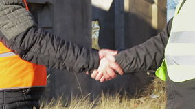 Two engineer's hands grip in greeted. Winter  day stock video footage