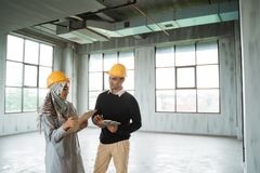 Two engineer in the space hall building project royalty free stock image