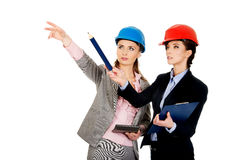 Two engineer woman discussing with eachother. Royalty Free Stock Photos