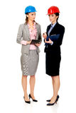 Two engineer woman discussing with eachother. Royalty Free Stock Photo