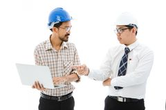 Two Engineer man blue helmet notebook consult stock photo