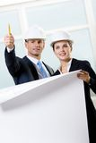 Two engineers with blueprint Royalty Free Stock Photo