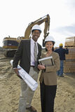 Two Engineers With Blueprint At Site Royalty Free Stock Image