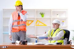 The two engineers colleagues working under project royalty free stock photography