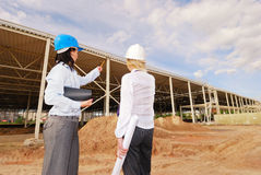 Two engineers at  construction site Stock Photo