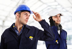 Two engineers in a construction site Royalty Free Stock Photography