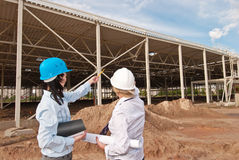 Two engineers at  construction site. On june 2009 Royalty Free Stock Photo