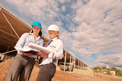 Two engineers at  construction site. On june 2009 Royalty Free Stock Image
