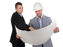 Two engineers discussing a building project Royalty Free Stock Images