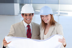 Two engineers discussing a construction project Royalty Free Stock Photo
