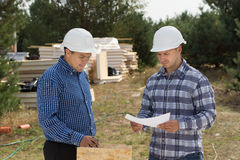 Two engineers having a discussion on site Royalty Free Stock Images