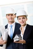 Two engineers keeping blueprints and model house Royalty Free Stock Images