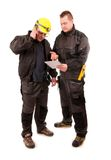 Two Engineers looking at tablet pc isolated on white background Stock Image
