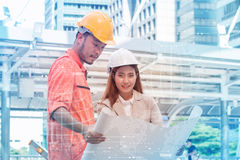 Two engineers meeting at construction site. Coworkers discussing. Stock Images