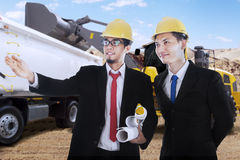 Two engineers observe the construction site Royalty Free Stock Image