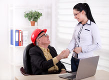 Two engineers shaking hands in the office Royalty Free Stock Photos