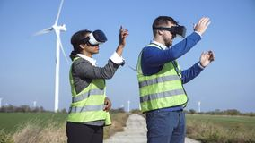 Two wind farm engineers in virtual reality googles stock image