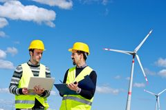 Two Engineers in a Wind Turbine Power Station Stock Image