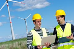Two Engineers in a Wind Turbine Power Station stock photo