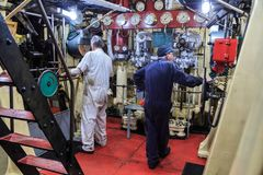 The engine room of an old steam tugboat stock photography
