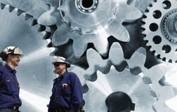 Engineers, workers with giant gear machinery Royalty Free Stock Images