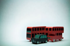Two English bus and one car Stock Images
