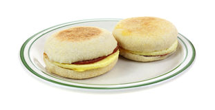 Two English Muffins on Plate Royalty Free Stock Images
