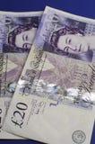 Two English Twenty Pound notes - vertical. Two English Bank of England Twenty Pound notes on blue background Stock Image