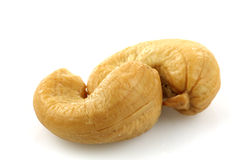 Two entangled cashew nuts Stock Photos