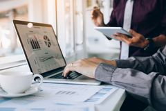 Two entrepreneur person working and colleague analyzing data for new start-up business and marketing.  royalty free stock images