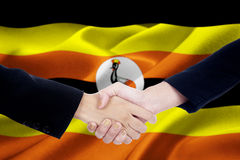 Two entrepreneurs with flag of Uganda Stock Photo