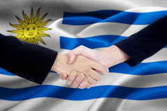 Two entrepreneurs and Uruguay flag Royalty Free Stock Photography