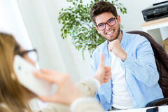 Two entrepreneurs working in the modern office. Royalty Free Stock Photos
