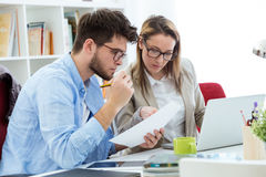 Two entrepreneurs working in the modern office. Stock Photo