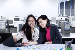 Two entrepreneurs working in office Stock Images