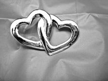 Two Entwined Hearts. On gray background Stock Image