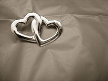 Two Entwined Hearts. On gray background Stock Images
