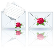 Two envelope and roses Stock Photos