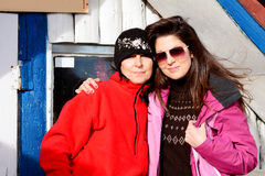 Two equipped hiker women hugging  in a high mountain.Mother and daughter Royalty Free Stock Photos