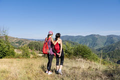 Two Equipped women hiking in a high autumn  mountain Stock Photography